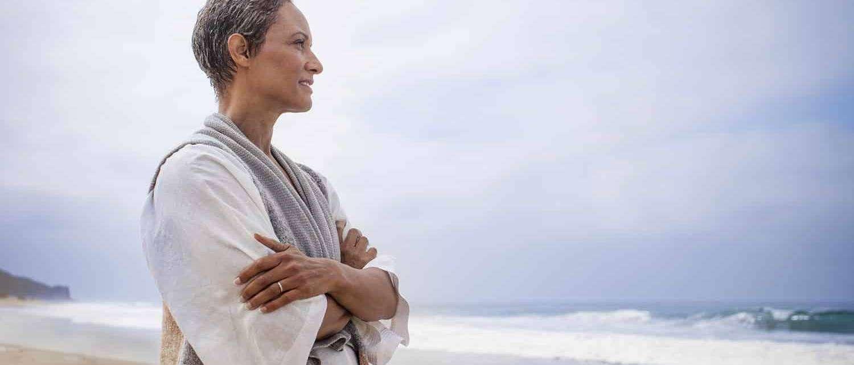 Senior Black Woman Relaxing on Beach 1